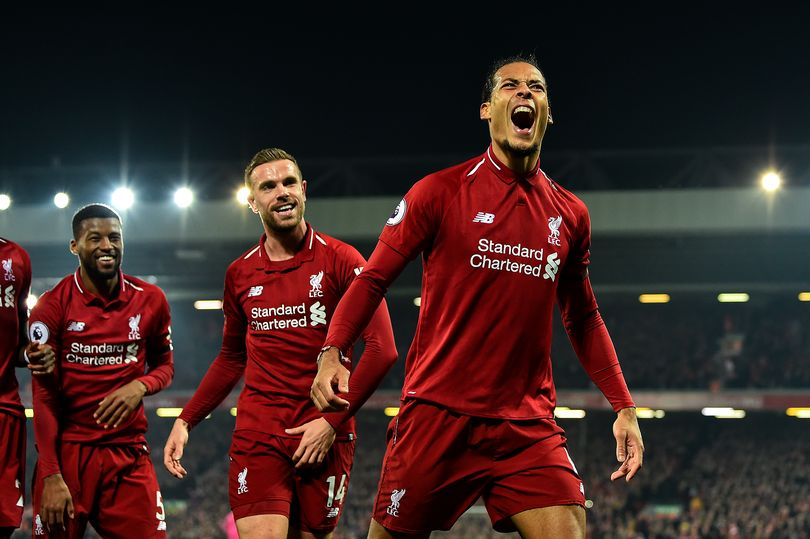 Liverpool's Virgil Van Dijk celebrates with his teammates after scoring against Watford